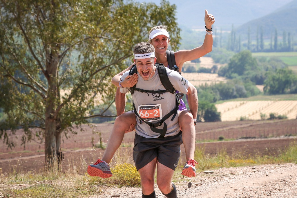Scott Rickard carries his wife Liezel during Stage 2 of the Dryland Traverse. Photo by Oakpics.com.